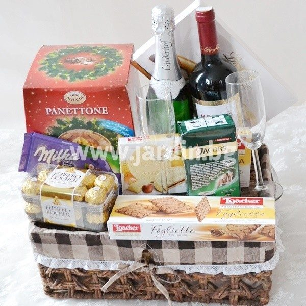 Basket with wine, chocolates and sweets